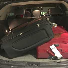 Photo of two large suitcases.